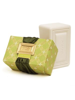 Image of This triple-milled bar creates a creamy, silky lather that gently cleanses your skin leaving it silky, refreshed and slightly scented. Each bar is hand-wrapped in custom designed prints with gold foil details, and tied with a fashionable satin ribbon lace