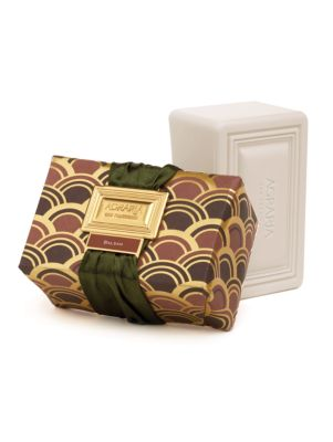 Image of This triple-milled bar creates a creamy, silky lather that gently cleanses your skin leaving it silky, refreshed, and slightly scented. Each bar is hand-wrapped in custom designed prints with gold foil details, and tied with a fashionable satin ribbon lac
