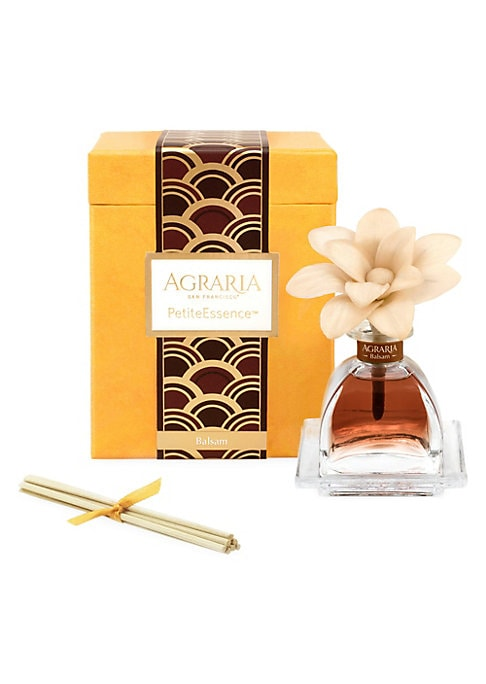Image of Agraria's new PetiteEssence diffusers are exact miniatures of the new AirEssence with flowers. Each 1.7 oz. PetiteEssence now includes one flower handmade with slices of balsa wood. As the perfumed essential oils are absorbed through the cotton wick, the