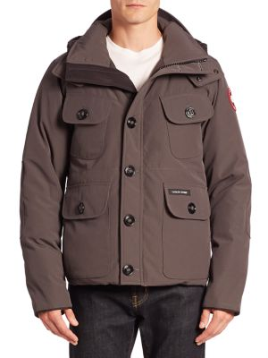 Image of Ample pockets lend sporty style to this durable coat, finished with a hood and filled with goose down for exceptional warmth. Hood with snap closure. Front zip and button closure. Long sleeves with logo patch. Front button flap pockets. Tonal elbow patche