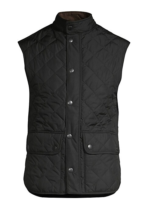 "Image of A sporty, sleeveless vest is carefully crafted with a quilted finish, adding a refined, tailored aesthetic. Sleeveless. Concealed front zip with snap closure. Buttoned waist flap pockets. Lined. About 27"" from shoulder to hem. Polyamide. Machine wash. Imp"