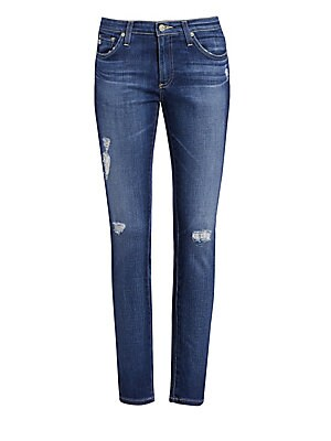 """Image of A polished and lean cut perfectly balances the distressed cool of these skinny ankle jeans. Five-pocket style Button closure Zip fly Belt loops Shredding detail Cotton/Lyocell/polyurethane Machine wash Made in USA SIZE & FIT Rise, about 8"""" Inseam, about 2"""