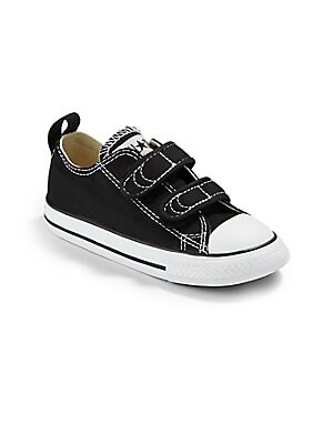 Image of A vibrant hue and double grip-tape closure update your little one's favorite pair of Chucks. Double grip-tape closure Canvas upper Cotton canvas lining Rubber sole Traditional Chuck insole Imported. Children's Wear - Children's Shoes. Converse. Color: Bla
