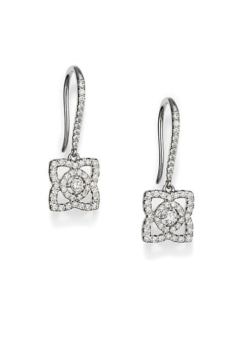 Image of From the Enchanted Lotus Collection. A lotus flower dangles upon a French wire of 18k white gold, casting the delicate shimmer of diamond pave, in an earring with understated, ethereal effect. .Diamonds, 0.4 tcw. Color: G+.Clarity: VS+.18k white gold. Len