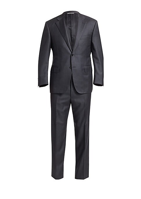 "Image of Handsome solid wool suit exudes a suave appeal. Wool. Dry clean. Made in Italy. Jacket. Notch lapels. Long sleeves. Buttoned cuffs. Front button closure. Chest welt pockets. Waist flap pockets. Dual back vents. About 30"" from shoulder to hem. Pants. Belt"