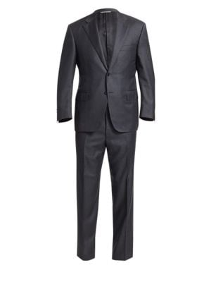 """Image of Handsome solid wool suit exudes a suave appeal. Wool. Dry clean. Made in Italy. Jacket. Notch lapels. Long sleeves. Buttoned cuffs. Front button closure. Chest welt pockets. Waist flap pockets. Dual back vents. About 30"""" from shoulder to hem. Pants. Belt"""