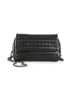 """Image of A classic style featuring luxurious leather in an allover woven design. Chain shoulder strap, 25?"""" drop. Snap flap closure. One zip pocket under flap. Three card slots. Suede lining.7?""""W X 4?""""H X 2""""D.Leather. Made in Italy."""