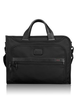 Image of Made from Tumi's signature ballistic nylon, this slim portfolio brief features front and back exterior pockets, interior pockets for your iPad, phone, electronics and accessories, plus room for paper and files. Anchored by comfortable leather carry handle