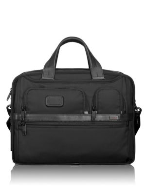 Image of An expandable brief case in sturdy nylon makes traveling a breeze with rear divider/laptop section featuring removable padded insert, two phone pockets, PDA pocket and an accessories pouch. Top zip closure. Double top handles. Exterior U-zip pockets. Exte