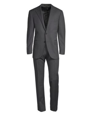 "Image of Perfectly tailored wool suit featuring two-button jacket and a comfortable pair of pants. Wool. Dry clean. Made in Italy. Jacket:.Notch lapels. Front button closure. Long sleeves with buttoned cuffs. Chest welt pocket. Waist flap pockets. About 29"" from s"