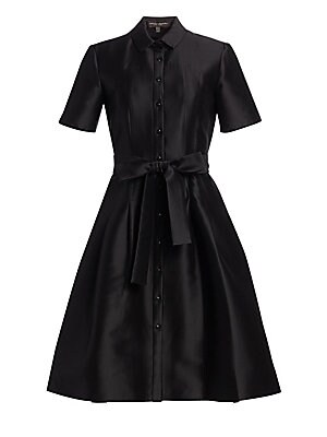 """Image of From the Icon Collection A satin finish and voluminous skirt infuse feminine sophistication into the classic shirtdress. Point collar Short sleeves Button front Shaping seams Self-tie belt Pleated skirt Yoked back Lined About 40"""" from shoulder to hem Cott"""