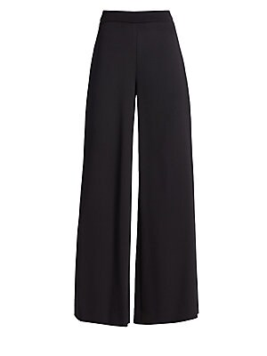 Image of An effortless fluidity is achieved with these pants thanks to a silk crepe construction. The wide leg is cut with just enough length to showcase a dramatic shoe. Banded waist Concealed side zip closure Lined Silk Dry clean Made in USA SIZE & FIT Wide-leg