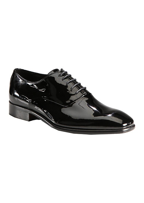 Image of EXCLUSIVELY OURS. Elegant, Italian-crafted lace-ups in glossy patent leather: the perfect accompaniment to formal occasions. Leather lining. Rubber sole. Made in Italy.