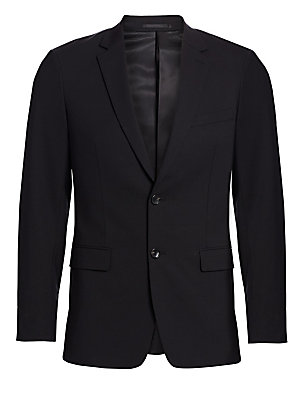 Image of From the Saks IT LIST THE JACKET The wear everywhere layer that instantly dresses you up. Meticulously tailored sportcoat with hand-stitched full canvas inner construction for a beautiful fit, in wool blended with a touch of stretch for ease. Notched lape