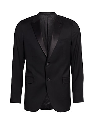 Image of From the Saks IT LIST THE JACKET The wear everywhere layer that instantly dresses you up. Meticulously tailored tuxedo jacket with hand-stitched full canvas inner construction for a beautiful fit, in pure wool highlighted with satin lapels and buttons. Pe