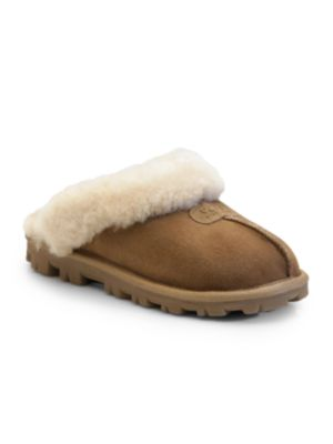 Image of .Soft and cozy downtime slip-ons warmed with shearling lining. .Suede upper. .Round toe. .Slip-on style. .Shearling lining. .Rubber sole. .Padded insole. .Fur type: Dyed sheepskin. .Fur origin: May be sourced from Australia, China, Italy, Ireland, New Zea