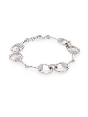 """Image of From the Horsebit Collection. Signature horsebit design detailed with shimmering diamonds. Diamonds, 1.01 tcw.18k white gold. Length, 6.5"""".Width, 0.5"""".Lobster clasp. Made in Italy."""