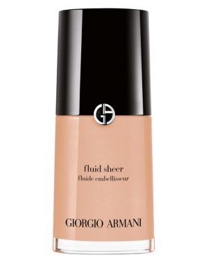 Image of Fluid sheer dresses skin in an illuminating veil of radiance. This unique, translucent formula is available in a range of versatile hues including makeup base shades, correcting shades and radiance boosting shades. Blend your favorite fluid sheer with fou