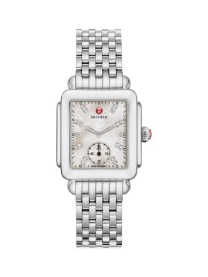 "Image of From the Deco Collection. A timeless style with mother-of-pearl dial and diamond hour markers. Swiss quartz movement. Water resistant to 5 ATM. Rectangular polished stainless steel case, 29mm x 31mm (1.15"" x 1.2"").Smooth bezel. Red cabochon crown. Sapphir"