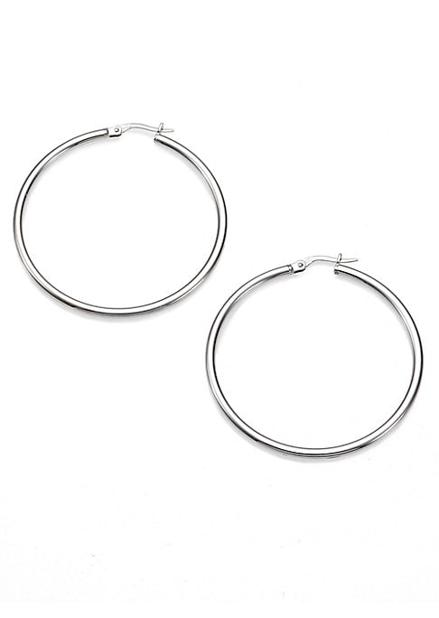 "Image of From the Designer Gold Collection. These slender, sleek hoop earrings are cast from 18k white gold in a size that's subdued enough for day, but still a striking accent at night. .18k white gold. Length, about 1.75"".Hinged post back. Made in Italy."
