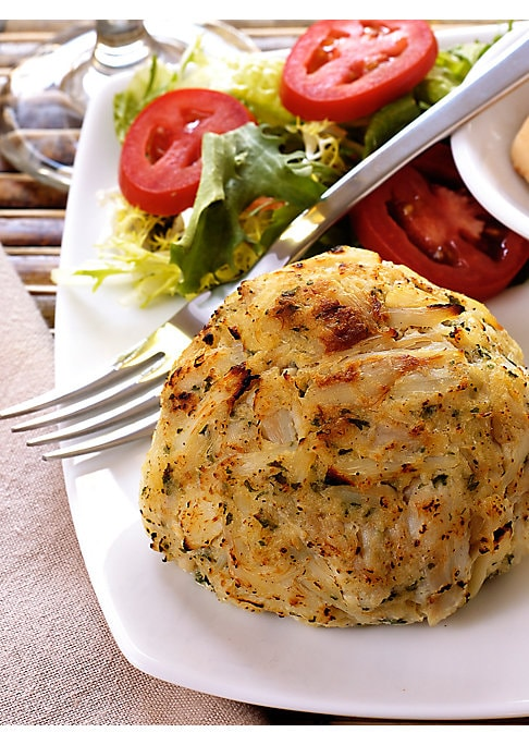 "Image of A treat from the sea, these 100% domestic blue crab cakes are filled with premium ingredients and subtle spices, from the original recipe developed at Baltimore's landmark restaurant and voted ""Best Crab Cake"" over 25 times. Includes: 12 cakes.4 ounces ea"