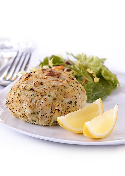 Image of A treat from the sea, these domestic blue crab cakes are filled with premium ingredients, from the original recipe developed at Baltimore's landmark restaurant.100% domestic blue crab. Voted Best Crab Cake more than 25 times. Includes 4 cakes, 8 ounces ea