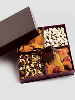 "Image of An elegant designer box filled with healthy treats and snacks. Includes Turkish apricots, Berry Blossom trail mix, mixed fanciful fruit with ruby red plums and California colossal pistachios. Serves 16 people 2 lbs. 9""W x 9""H x 2""D Shelf life: 6 months Ma"