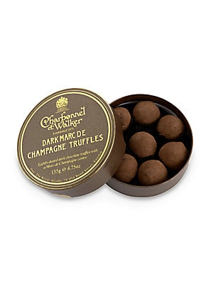 "Image of A collection of signature dark chocolate truffles with Marc de Champagne centers, handmade in the UK by the boutique's confectionery artisans, then delivered in a lovely little gift box. Includes 8 truffles 4.5 oz. Box: 1¼""H X 4½"" diam. Hand"