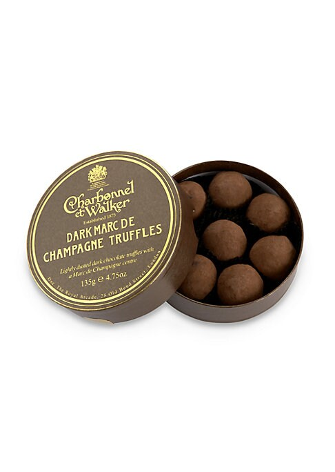 """Image of A collection of signature dark chocolate truffles with Marc de Champagne centers, handmade in the UK by the boutique's confectionery artisans, then delivered in a lovely little gift box. Includes 8 truffles.4.5 oz. Box: 1¼""""H X 4½"""" diam. Hand"""