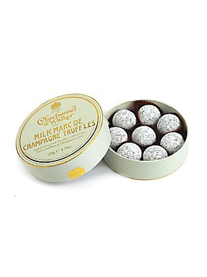 "Image of A collection of signature milk chocolate truffles with Marc de Champagne centers, handmade in the UK by the boutique's confectionery artisans, then delivered in a lovely little gift box. Includes 8 truffles 4.5 oz. Box: 1¼""H X 4½"" diameter H"