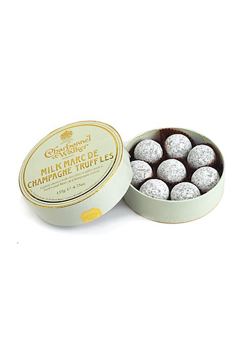 """Image of A collection of signature milk chocolate truffles with Marc de Champagne centers, handmade in the UK by the boutique's confectionery artisans, then delivered in a lovely little gift box. Includes 8 truffles.4.5 oz. Box: 1?""""H X 4?"""" diameter. Handmade in th"""
