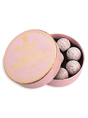 "Image of A white chocolate truffle with a hint of strawberry and milk chocolate Marc de Champagne centre. Includes 8 truffles 4.5 oz. Box: 1¼""H X 4½"" diam. Handmade in the United Kingdom. Drop Ship Prgrm - Food. Charbonnel et Walker."