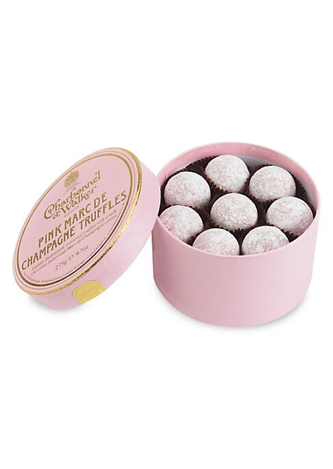 """Image of A collection of signature pink chocolate truffles with Marc de Champagne centers, handmade in the UK by the boutique's confectionery artisans, then delivered in a lovely little gift box. Includes 16 truffles.9.7 oz.3.625""""H X 4.475"""" diam. Handmade in the U"""