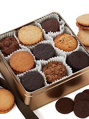 Image of Lovers of all things chocolate will rejoice when they open this gold tin full of delicious sin. 36 cookies total Includes 4 of each of the following: Chocolate chip, chocolate chocolate chip, oatmeal chocolate chip, chocolate peanut butter ganache-filled