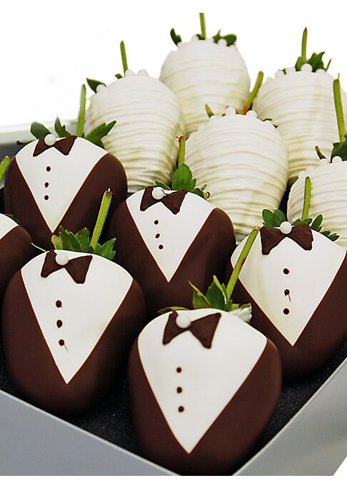 """Image of Say """"I do"""" to the most luscious treats imaginable. An exquisite collection of ripe strawberries includes brides in gowns of imported white chocolate and grooms who pair white chocolate shirts with dark chocolate vests and jaunty bow ties. An elegant gift"""