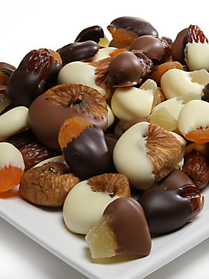 Image of A divine assortment of dried pineapple, apricots, dates, prunes and figs are individually hand-dipped in milk, dark and white chocolate.A distinctive gift selection certain to delight friends, relatives and co-workers alike. Serves: Two Covered in Belgian