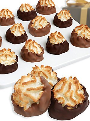 Image of A dozen delicate macaroons are baked with an abundance of coconut flavor, then individually hand-dipped in Belgian milk, dark and white chocolates. A distinctive gift fit for friends, family and co-workers alike. Includes: 12 macaroons Serves: 12 Covered