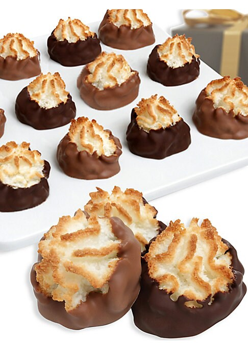 Image of A dozen delicate macaroons are baked with an abundance of coconut flavor, then individually hand-dipped in Belgian milk, dark and white chocolates. A distinctive gift fit for friends, family and co-workers alike. Includes: 12 macaroons. Serves: 12.Covered