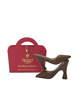"""Image of From Britain's master chocolatiers since 1875, a single, sweet pair of chocolate pumps is tucked inside each signature """"handbag"""" box. Set includes: 3 boxes Pink Handbag - Milk chocolate Purple Handbag - Dark Chocolate Gold Handbag - Milk Sea Salt Caramel"""