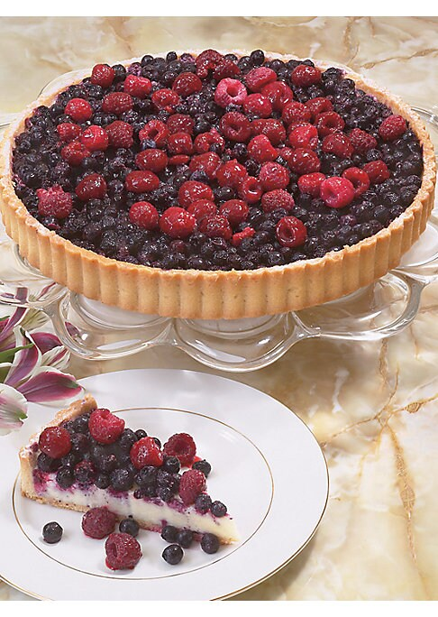 "Image of Berry, berry yummy! A butter cookie tart shell is filled with a light, almond flavored pastry cream and topped with a mountain of wild blueberries and raspberries.""Outstanding Dessert"" winner, International Fancy Food Show. Hand made and decorated.9?"" dia"