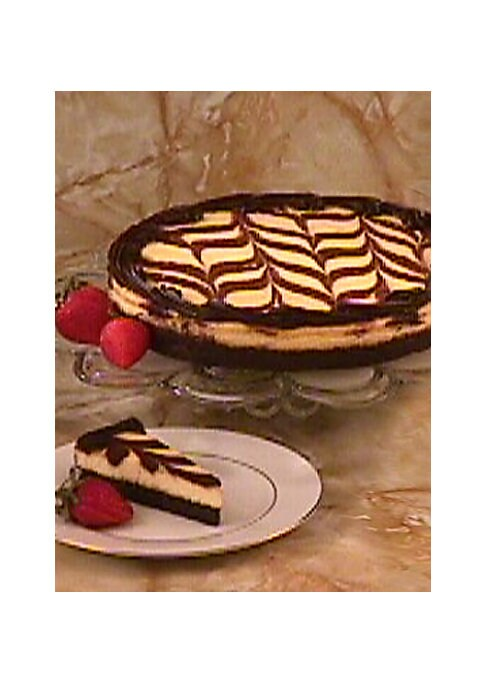 "Image of If you can't choose between chocolate and cheesecake, now you don't have to. The best of both worlds: half flourless chocolate truffle cake and half flourless cheesecake.""Outstanding Dessert"" winner, International Fancy Food Show.10"" diameter.Net weight:"