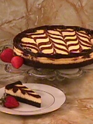 """Image of If you can't choose between chocolate and cheesecake, now you don't have to. The best of both worlds: half flourless chocolate truffle cake and half flourless cheesecake.""""Outstanding Dessert"""" winner, International Fancy Food Show.10"""" diameter.Net weight:"""