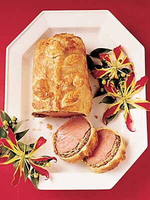 Image of Multiple flavors and textures combine to create this two pound tenderloin layered with duck and goose liver pate, then accented with black truffles and mushroom duxelles; food is wrapped in golden puff pastry that seals in the flavors and provides a delic