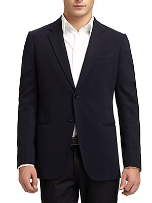"""Image of Classic tailored style in easy-going jersey Notched lapel Button-front Welt chest pocket Front besom pockets Side vented About 31"""" from shoulder to hem Viscose/rayon/nylon/elastane Dry clean Imported. Men Luxury Coll - Armani Sportswear. Armani Collezioni"""