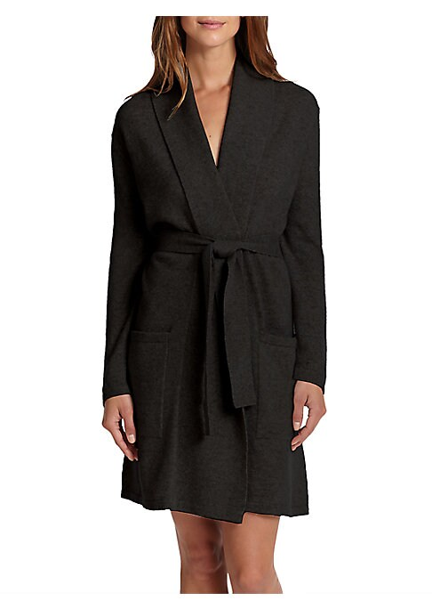 Image of This cashmere short robe features front pockets and is soft to the touch for the perfect lounger. Shawl collar. Long sleeves. Front patch pockets. Self-tie belt at waist. Cashmere. Dry clean. Imported.