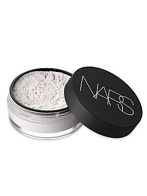 Image of Light Reflecting Loose Setting Powder enhances the look of foundation without a trace of color and prolongs makeup wear. This invisible silky powder is infused with Photochromic Technology to diffuse light and adjust to new sources of light throughout the
