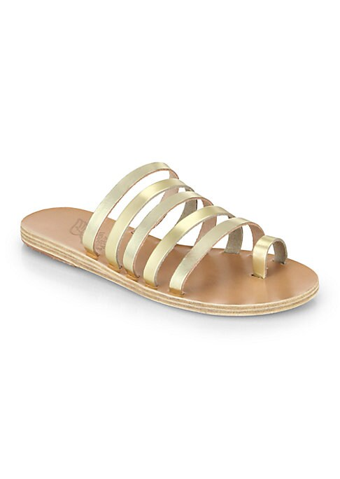 Image of Gleaming metallic illuminates these pared-back, multi-strap leather sandals. .Metallic leather upper. Toe-ring strap. Leather lining and sole. Made in Greece.