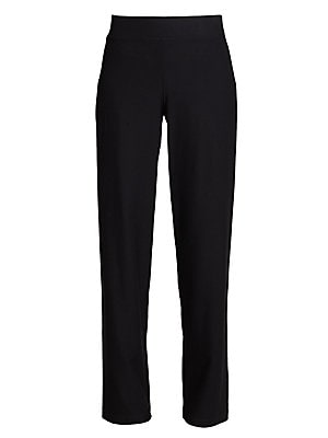 "Image of Smooth-fitting stretch knit has easy, pull-on comfort. Elasticized waistband Clean, no-pocket style Inseam, about 32"" Viscose/nylon/Lycra® Dry clean Imported. Modern Collecti - Eileen Fisher. Eileen Fisher. Color: Black. Size: S."
