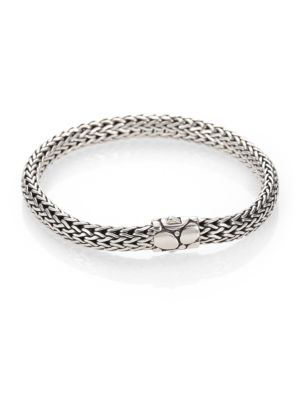 """Image of From the Kali Collection. A sophisticated style of sterling silver in John Hardy's signature woven design, set with a barrel clasp engraved with intricate Kali pebbles. Sterling silver. Length, 7.25"""".Width, 6.5mm. Push-lock closure. Imported."""