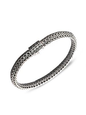 """Image of From the Classic Chain Collection. John Hardy's signature chain bracelet, intricately woven of sterling silver, secures with a barrel clasp of matching engraved design. Sterling silver. Length, 7.5"""".Width, 6.5mm. Push-lock clasp. Imported."""